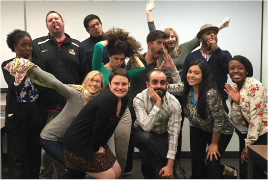 Picture of 12 individuals striking silly poses at the conclusion of a semester's class.