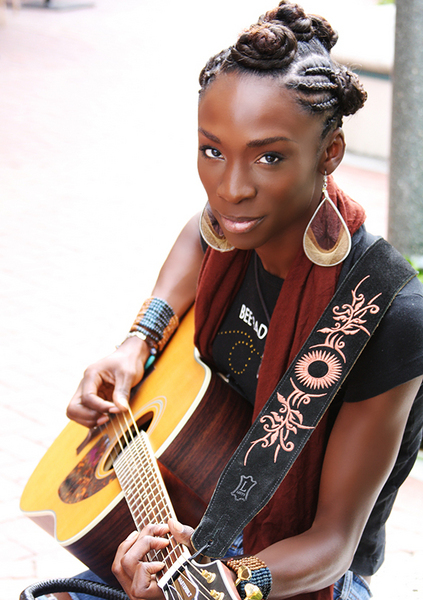 Picture of Angelica Ross with a guitar