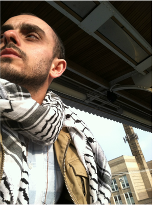 Picture of T.J. with keffiyeh at train station
